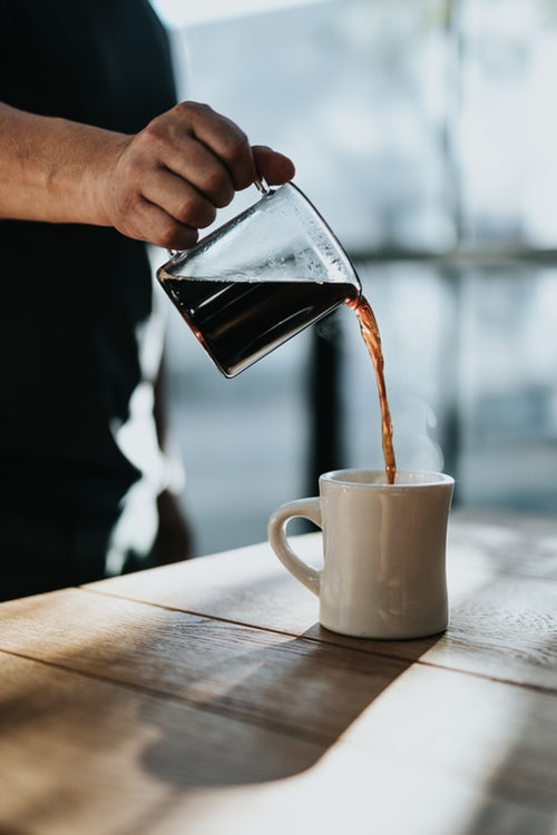 Pouring coffeee